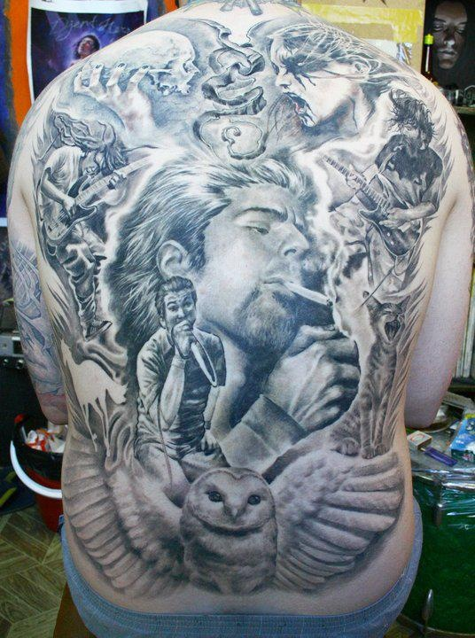 Axi goregots super genius tattoo seattle wa black and for Back mural tattoo designs