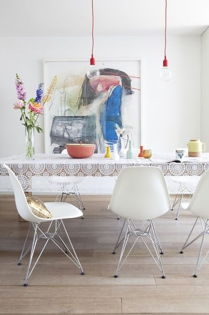 Art // kitchen // dining table // eames chairs