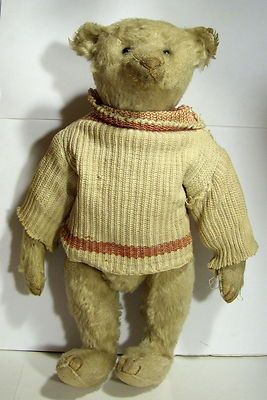 "Antique 12"" Steiff Teddy Bear. He's wearing a Tan Sweater. He has such a darling face...looks to me to have been originally white.  Photo via Ebay"
