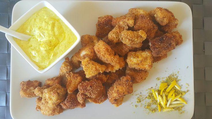 Bocconcini di pollo pistacchio e limone con salsa al curry