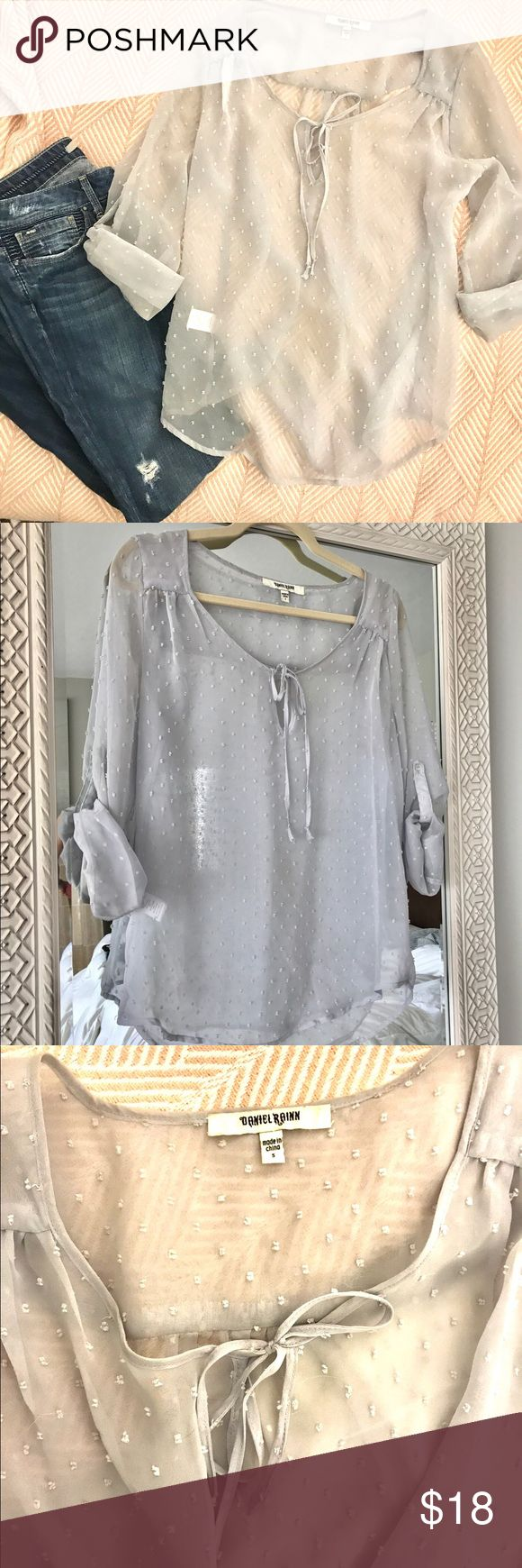 Daniel Rain Peasant Blouse - Sheer Grey Pre-loved and gently worn Daniel Rainn dotted sheer grey peasant style blouse. Scoop neck. Peekaboo eyelet. Bohemian. Pair with jeans and heels for a perfect daylight to evening transitional outfit! Daniel Rainn Tops Blouses