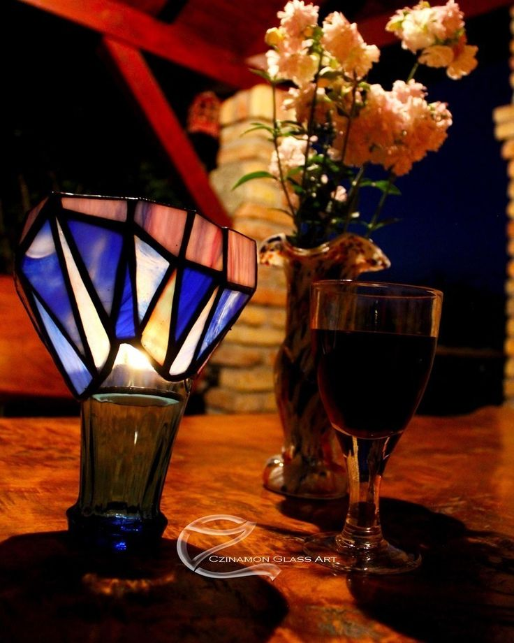Evening mood lighting with a glass of wine Broken cocacola cup and which is left of the cocacola glass was transformed  #czinamon #czinamonglassart #moodlight #lighting #candelholder #candel #wine #evening #tiffanyglass #cocacolaglass #changed #transformed #glass #flower #broken #light #table #mood #summernight #summer #blue #sky #eveningsky #hot #hotnight