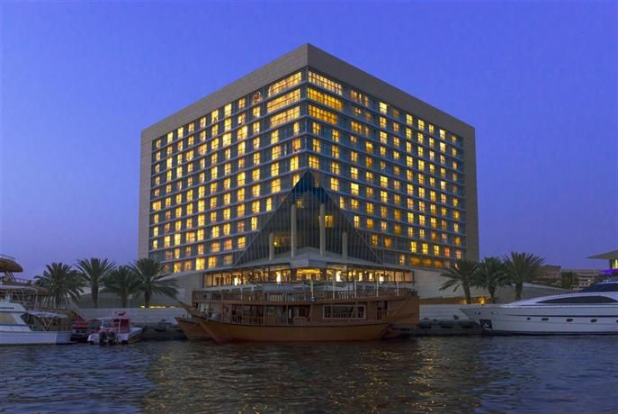 OopsnewsHotels - Sheraton Dubai Creek Hotel and Towers. Situated just a few steps from National Bank of Dubai (building), this modern hotel offers both a bar and a restaurant. Popular facilities, such as a sauna and outdoor tennis courts, ensure an enjoyable stay in Dubai.   Sheraton Dubai Creek Hotel and Towers provides a golf course, a coffee bar and 24-hour room service. Guests have access to express check-in/check-out, 24-hour reception and a meeting room.