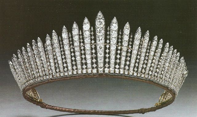 The Fringe Tiara:  The Royal Collection states that Queen Mary had the piece made in 1919 from a necklace she received from Queen Victoria as a wedding present. They specify that Victoria bought the necklace from Collingwood & Co. jewelers in 1893.    It was given to Queen Elizabeth in 1936.   Elizabeth lent it to her namesake daughter for its history-making appearance atop the bridal veil.  She lent it out again to her granddaughter, Princess Anne, for another bridal appearance.