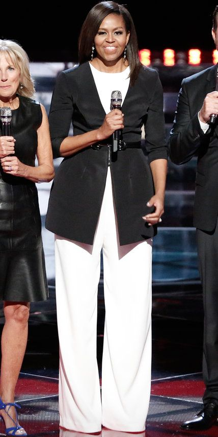 2016  For an appearance on NBC's The Voice, the First Lady wore a black tailored blazer and wide-legged white jumpsuit that was belted at the waist.