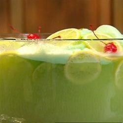Here's a festive and tangy green punch made with lime sherbet, pineapple juice, and ginger ale that you can make for your guests in just a few minutes.