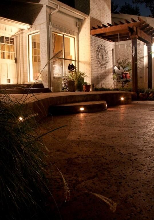 Keep it safe by lighting the steps from the lower patio to the raised patio.By Outdoor Signature in Argyle, TX.