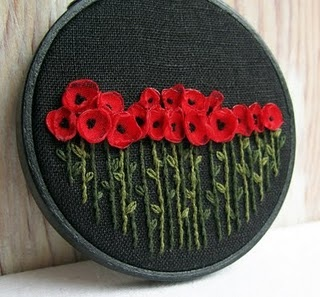 something to do with all the little fabric flowers...flanders field, here