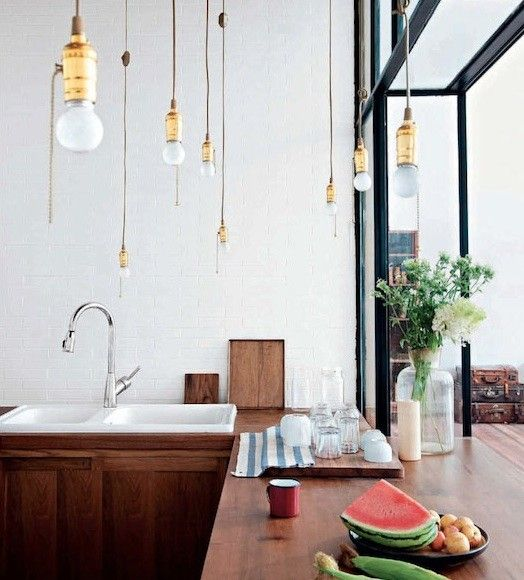 Kitchen with wood countertops and lightbulb pendants in Beijing, Remodelista