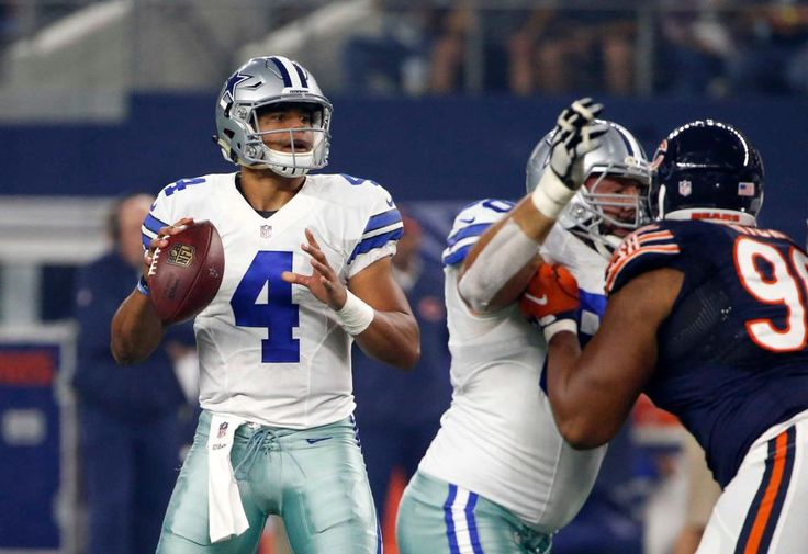 Dallas Cowboys quarterback Dak Prescott (4) prepares to throw a pass in the first half of an NFL football game against the Chicago Bears, Sunday, Sept. 25, 2016, in Arlington, Texas.