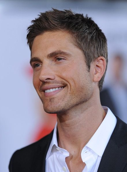 Eric Winter.  He looks too pretty here, but so sexy when his head is shaved.