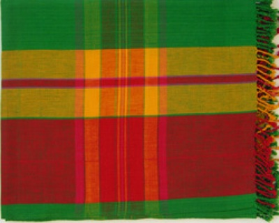 Beautiful handwoven tablecloth woven by a women's cooperative from Rabha community from Assam in NE India. The main colour is green and the border is interwoven with red and yellow with hand rolled tassles hanging on two sides.Ideal for those summer parties outdoors.Size is 176 length X 117 width cms.