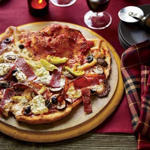 Pizza Vesuvio with the Works - Topped with artichoke hearts, salami, ricotta, and mushrooms, this easy pizza has a bonus calzone-style end stuffed with the same ingredients.