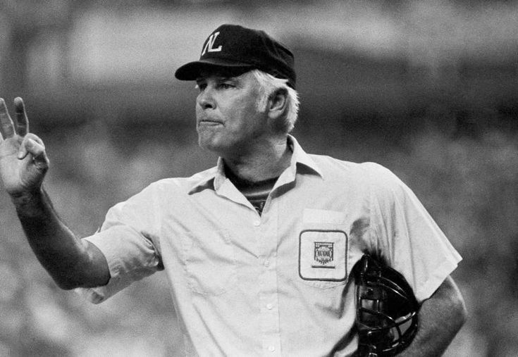 FILE- In this Oct. 11, 1980, file photo, plate umpire Doug Harvey gestures before play resumes in the fourth inning of a baseball game between the Astros and Phillies in Houston. Harvey, one of 10 umpires enshrined in the baseball Hall of Fame, died Saturday, Jan. 13, 2018. He was 87.