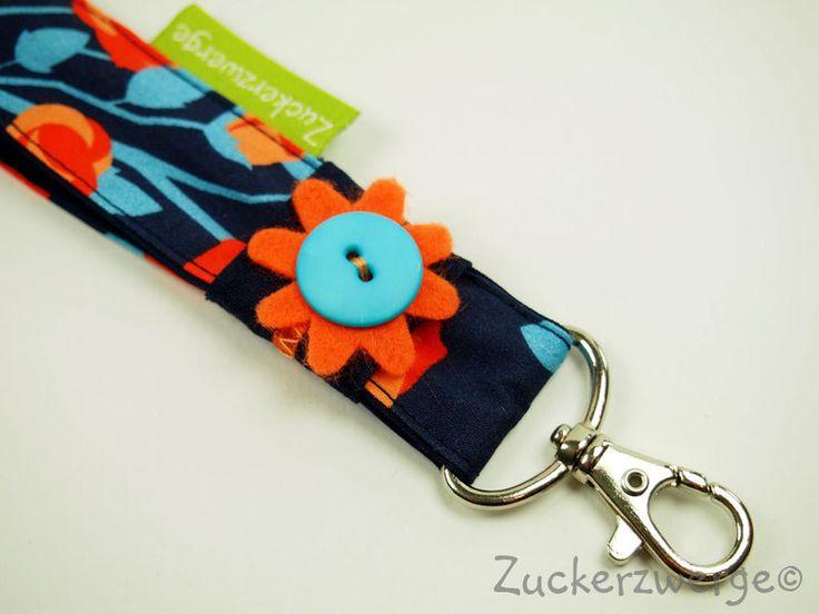 -Kurzes Schlüsselband mit Rosen in orange und türkis -Länge ohne Karabiner ca. 16 cm, Karabiner 4 cm -Schlaufe schlicht dunkelblau mit Satinband ...
