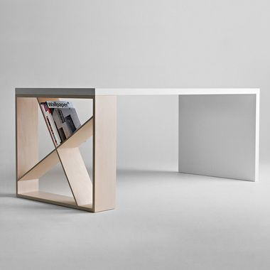 "J -Table. features a leg playing with asymmetric orthogonal lines that can be used as a bookcase. designed by Jean Francois Gomrée: ""Full of personality despite its formal rigour, this table can be included in multiple space configurations, including those of home or working environments."""