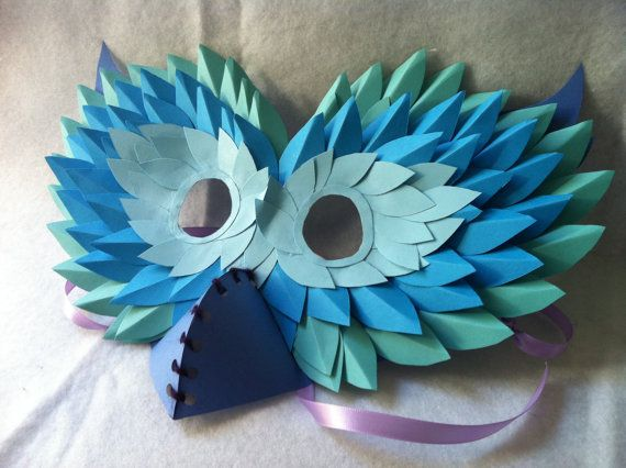 "Make the eye holes farther apart and use aged book pages for the paper ""feathers"" and maybe make a different beak"
