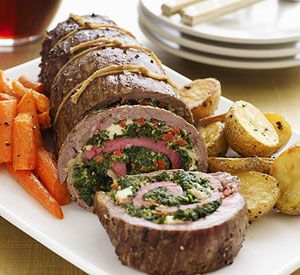 This roasted flank steak stuffed with a delicious spinach, blue cheese, and roasted red pepper filling makes an impressive main-dish recipe for family and friends.