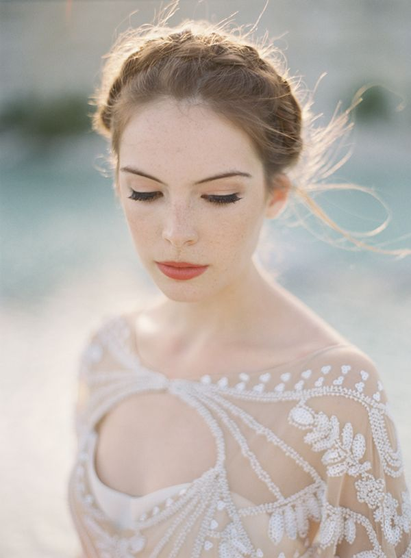 Dramatic Desert Wedding Inspiration via Once Wed, Photography: Brett Heidebrecht | Gown: Rue de Seine courtesy of The Dress Theory | Makeup and Hair: Tracy Melton Artistry | Creative Direction + Styling: Kylie Swanson | Florals + Styling: Alicia Rico of Bows and Arrows
