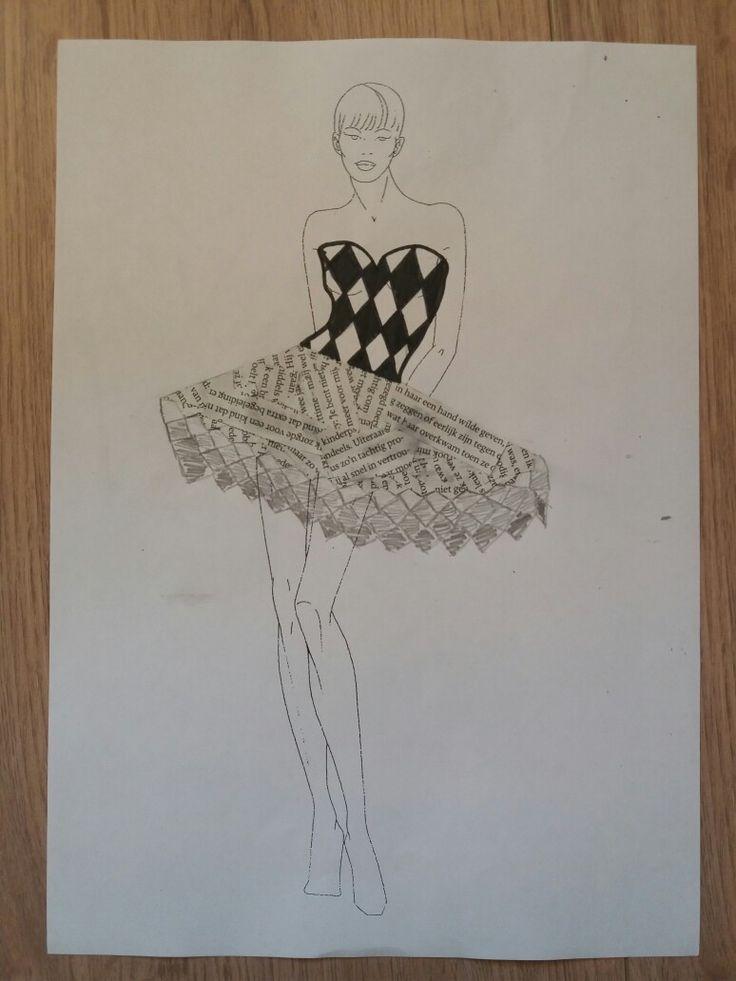 Ontwerp gemaakt van een zwart witte bovenkant en een gevouwen papieren rok, de rok is verwerkt in het definitieve ontwerp.