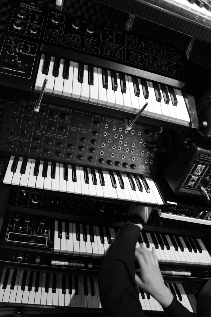 Wall of analog synthesizers.