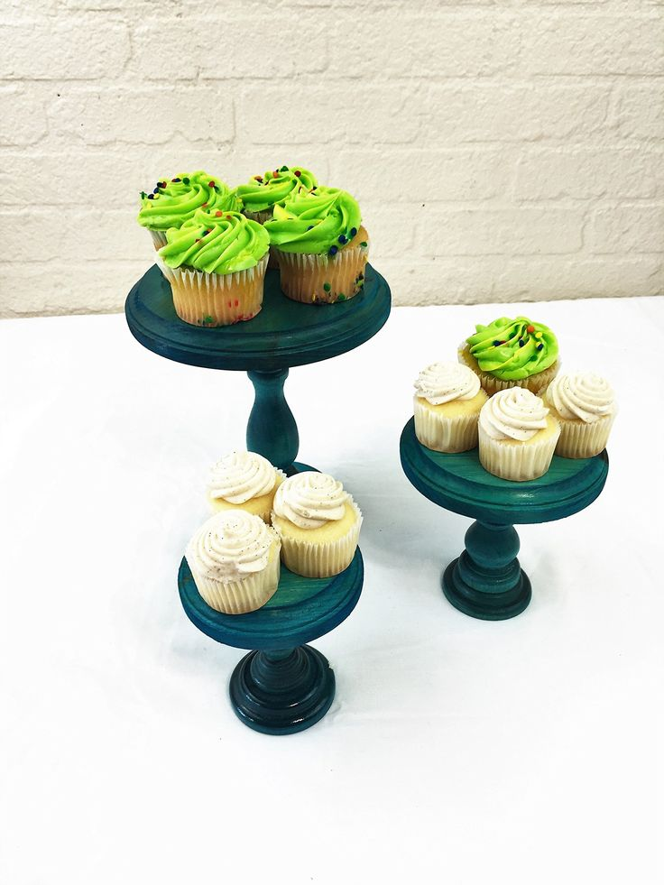 """Set of 3 Turquoise Round Wood Cupcake Stands Display Riser Pedestals. Please read our listing in full for policies and shipping times as well as dimensions of each item. Set of 3 Round wood cupcake stands or display risers. These pieces have so many uses and are a beautiful accessory on any table. Use as a cupcake stands, cake stands, display risers or a multitude of other uses. These solid wood cake stands have routered edges fora decorative finish. The largest stand is 8"""" tall and 6""""…"""
