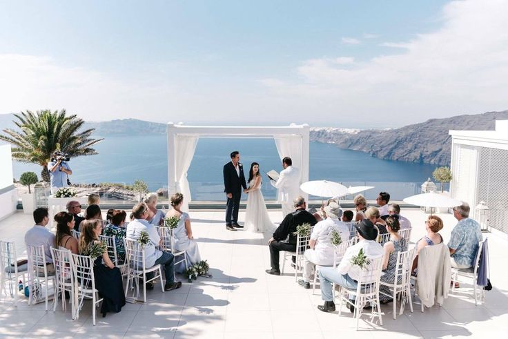 Smith Grant & McSevich Emily .Santorini Weddings, Wedding venue, Wedding ceremony and reception, Sunset view, Ionian Weddings, lecielsantorini, Santorini, wedding, weddingphotography, loveisintheair, weddingplanner, santorinigreece, weddinginsantorini, weddinginspiration, destinationwedding, love, bride, weddingday, groom, brideandgroom, weddingdress, santorinivenues, Imerovigli, sunset, emotions, storyteller, couple.