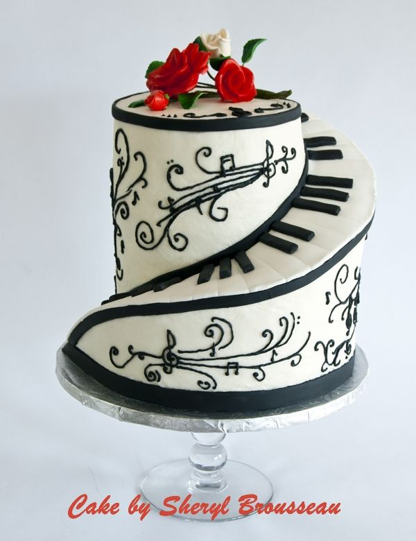 Piano Cake - Buttercream finish and fondant keyboard, with airbrushed gumpaste roses. Design is inspired by mommachris's spiral piano cake.