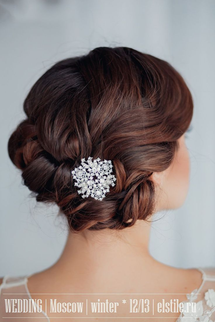 Wedding Hairstyle with braided curl updo & winter hair clip.