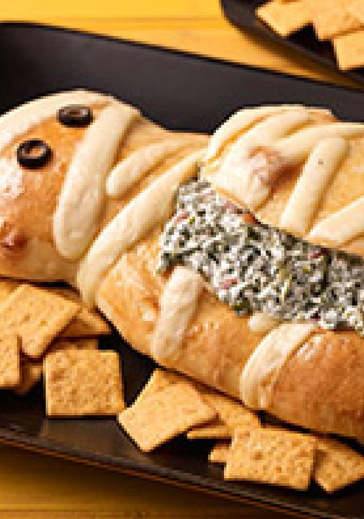 Halloween Mummy Spinach Dip -- Bake this fun mummy-shape bread loaf, and you can be sure this spinach dip will win for Best Costume at your next Halloween party.