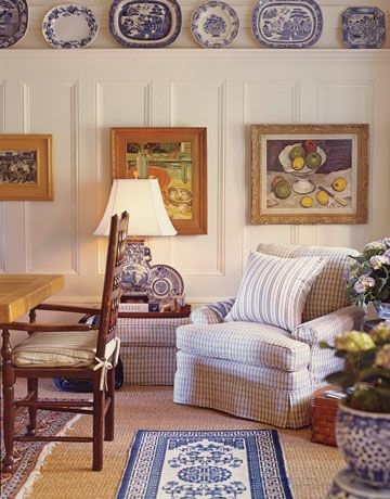 """SF house of Patrick Wade and Dave DeMattei (West Elm, WS Home); """"Dining Room Corner: Dining Room Corner  A Ralph Lauren-upholstered armchair provides a cozy seating area in a corner of the dining room. Oriental rugs on top of sisal add a layer of color and texture. Paintings of food by Marion Vinot."""""""