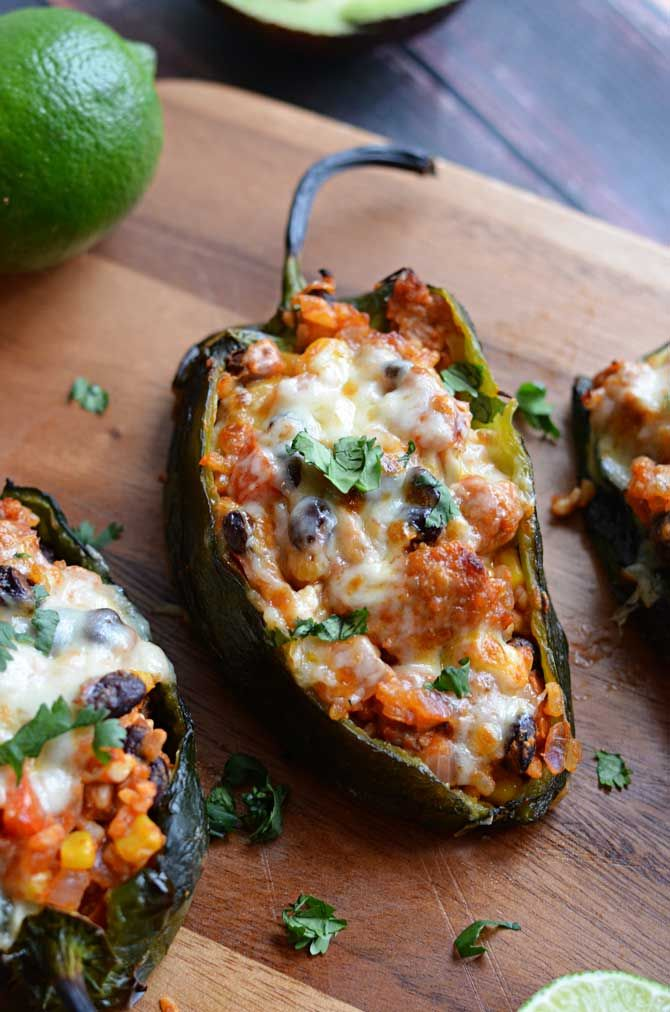 Mexican Stuffed Peppers.  Roasted poblanos stuffed with chorizo, rice, beans, corn, and cheese!  So good, I had to make them again. | hostthetoast.com