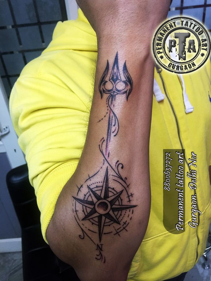 Trishul tattoo, compass tattoo, compass tattoo with detail design and trishul , shiva trishul tattoo, religious tattoo Done by - Deepak Kalra at Permanent Tattoo art