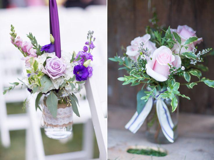 Pretty pastel flowers in vintage jars at tent wedding in Aylmer