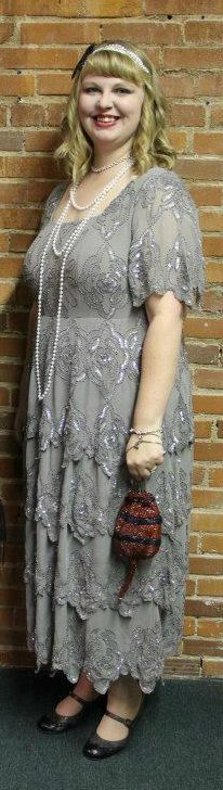 1920's outfit I wore to a murder mystery.  I bought the dress at Name Brand Clothing, the purse is vintage, the headband is from Target, the feather clipped to the headband is from a craft store, the shoes are from eBay, and the pearls are flapper pearls from a costume store.
