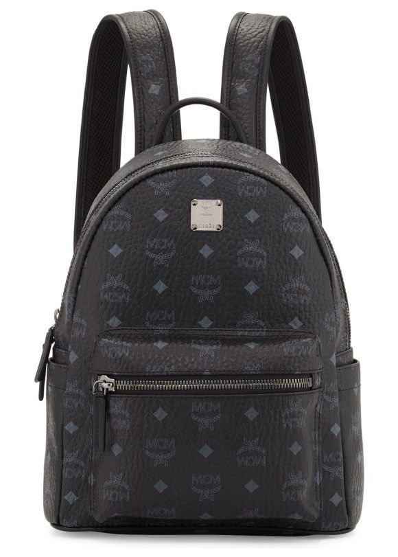 "Stark Small No Stud Backpack by MCM. MCM monogrammed backpack in coated canvas. Rolled top handle; 3.3"" drop. Adjustable shoulder straps; 13"" drop. Logo p..."