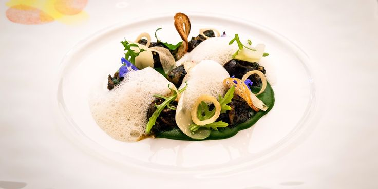 Snails served on a coulis of watercress with garlic crisps