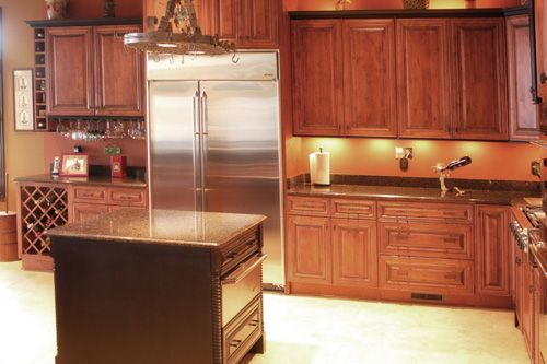 Charleston chestnut finish kitchen cabinets note the bar Bathroom cabinets greensboro nc