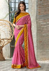 Look regal in ceremonies draping this Art Matka Silk Saree in Dark Pink. The ensemble is detailed with Abstract Print in Golden. It is highlighted with a contrasting Lace and Patch Border Work. Accompanied by an Unstitched Art Matka Silk Blouse in Ochre. Do Note: Blouse shown is for presentation purposes only. (Slight variation in actual color vs. image is possible.)