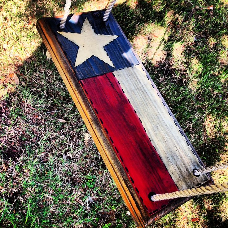 You must become totally obsessed with all things Texas.  Whether it's your tree swing, your garage door, or your kitchen counter tops, something in your home must be painted like the Texas State Flag.