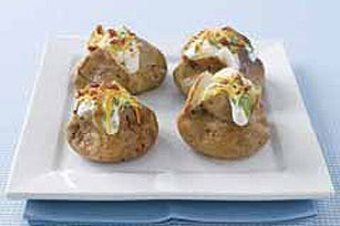 Grilled Baked Potatoes- Awesome way to prepare baked potatoes in the summer! Super easy and delicious!