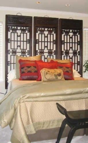 antique Chinese windows used as headboard - love this idea
