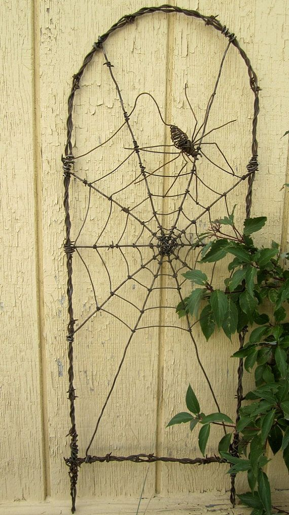 This is SO cool!!  Spinning Spider In A Web Barbed Wire Garden by thedustyraven