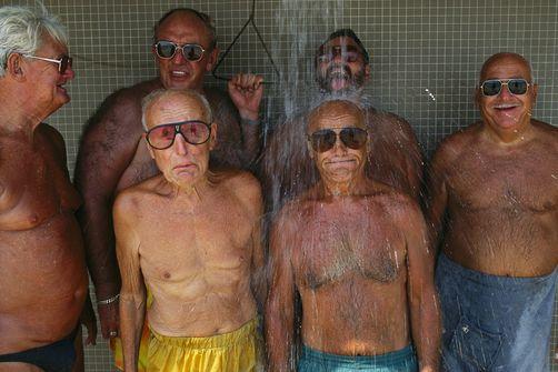 Elderly swimmers shower after a dip in Boston's Dorchester Bay.  Boston, Massachusets, USA.  Joel Sartore