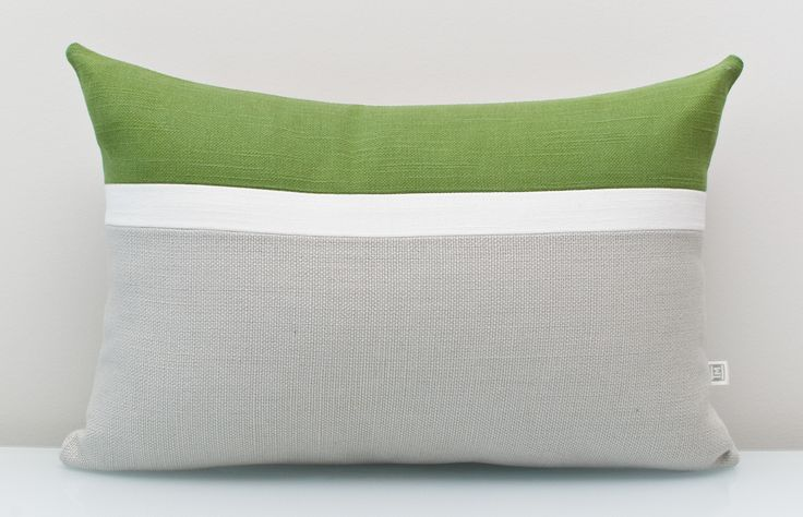 Green Pillow in 100% Cotton An ALL NATURAL Colorblock pillow using environmentally friendly fabrics. Add a sophisticated, earthy aesthetic to any space with olive green accent combined with gray and white to make it pop. FREE customization available