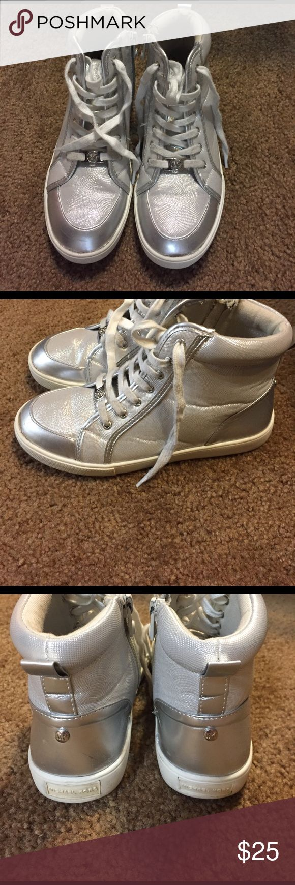 Micheal Kors girls high top sneakers size 3 Michael Kors girls platinum high top sneakers size 3, some light scratches,  Worn about three or four times, I paid about $89. Ask questions thank you Michael Kors Shoes Sneakers