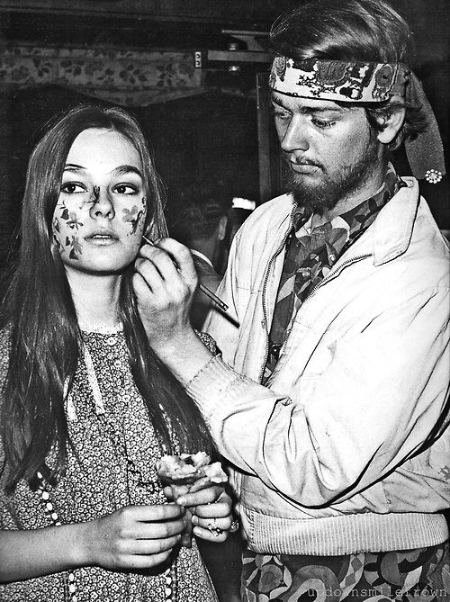 Preparing for a New York Be-In. Painted faces were a common fashion in the 1960s, whenever teenagers or youth would protest the war and promote peace.