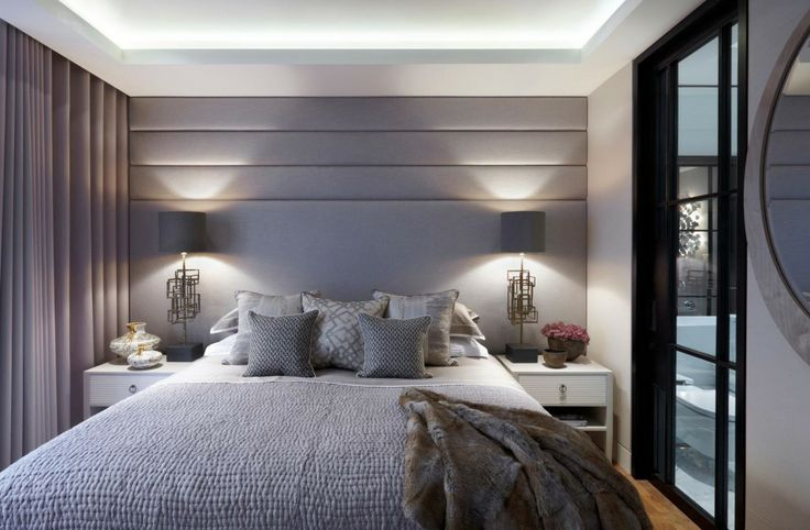 contemporary bedroom with padded headboard wall in soft shades of dove grey | Helen Green - Lateral Apartment, Regents Park