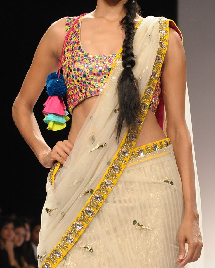 Net Sari and Choli with Mirror Work and embellished border. Light  simple yet striking.