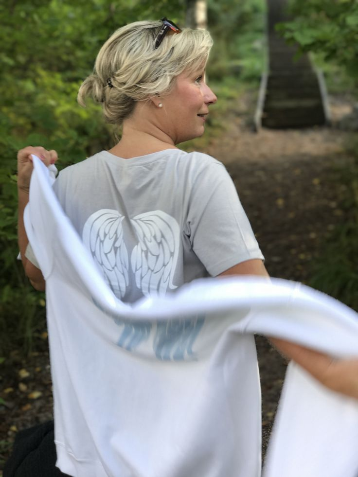 Angel wings on back of tees and sweaters.